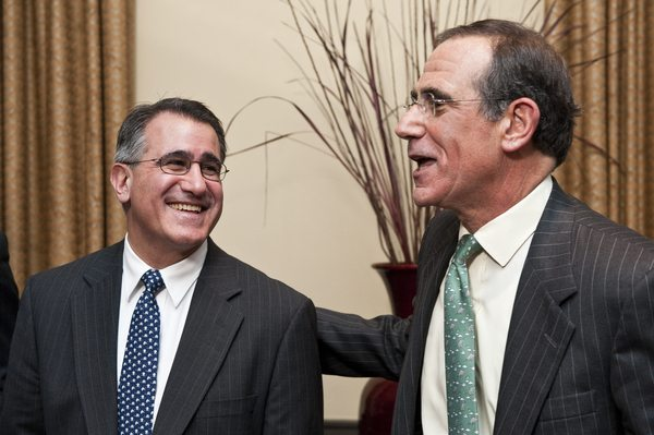 Jim Stern, Chairman of the Board of Trustees, congratulates incoming Tufts President Anthony Monaco.