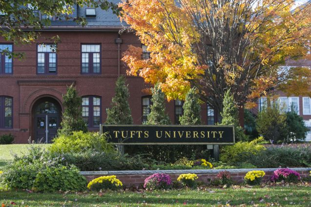 Sign of Tufts University on campus